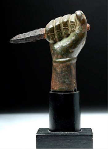 roman hand clutching iron dagger